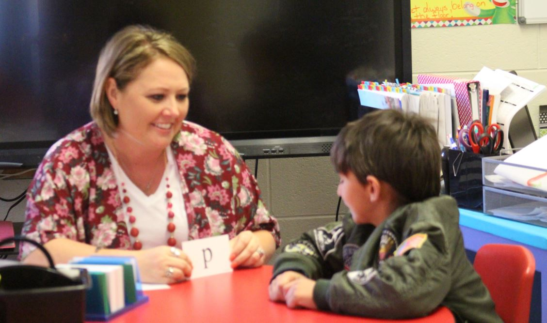 Mendy Boyd and first-grader Keenon Bennett, have a one-on-one reading lesson. Boyd teaches both reading and provides additional reading conferences to students, as well.