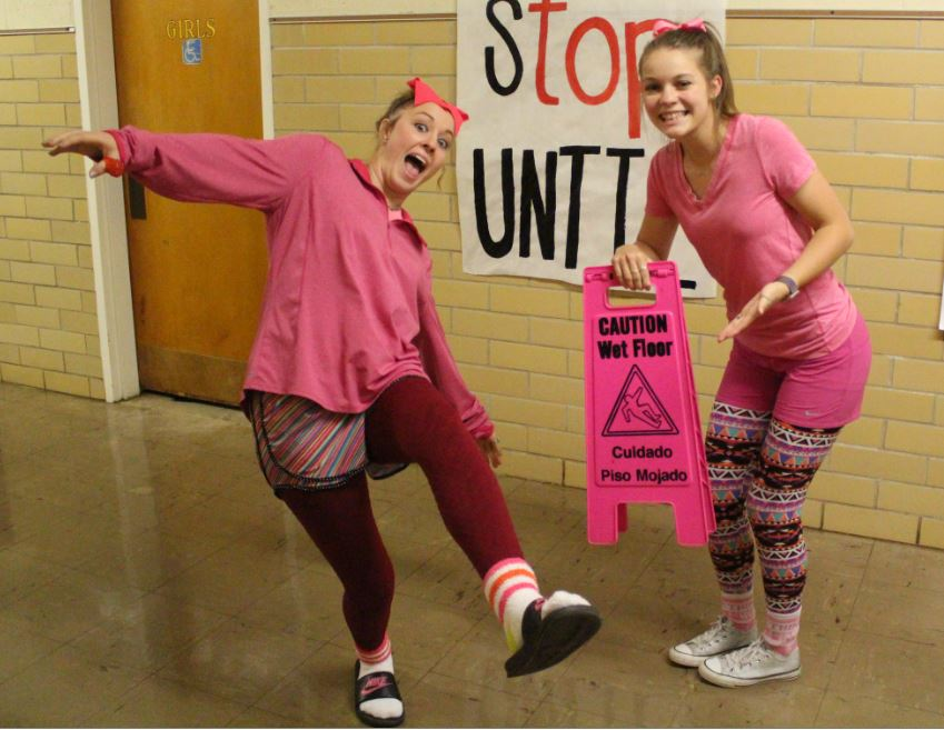 Juniors+Reganne+Boyd+and+K%27Leigh+Keesee+pose+for+a+picture+showing+off+their+pink+outfits.+Groom+students+wore+their+pink+clothes+to+support+people+who+suffer+from+breast+cancer.%22I+provided+Reganne%27s+pink%2C%22+Keesee+said.