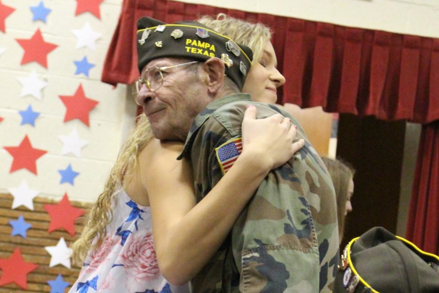 Student+Council+Vice+President+Chelsey+Lamb+gives++a+hug+to+a+member+of+the+Pampa+Veterans+of+Foreign+Wars+group+during+the+Veterans+Day+Program.+Veterans+Day+is+an+official+United+States+public+holiday+that+honors+military+veterans%2C+who+served+in+the+United+States+Armed+Forces.+Groom+students+-+from+elementary+to+high+school+-+help+with+this+event.+%22I+really+enjoyed+the+show%2C%22+sophomore+representative+Kodi+Tiffin+said.+%22It+was+nice+to+see+the+veterans+receive+a+gift+from+our+school+because+we+thank+them+for+their+service.%22
