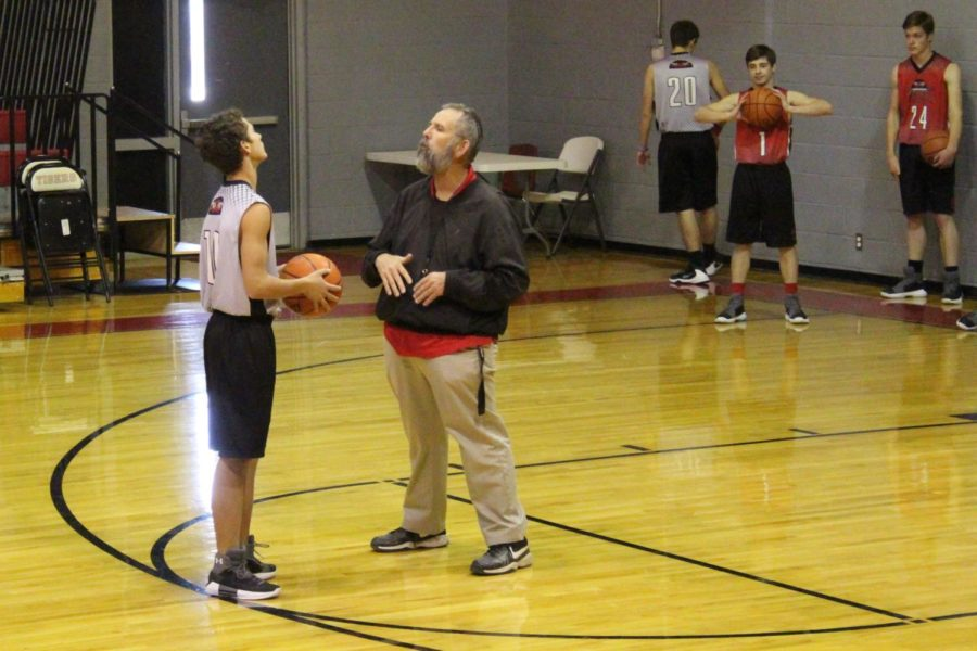 Sophomore William Kelly gets a lesson from Coach Tony Dodson, as they practice for tomorrow's game against Miami. Tonight, at 5:30, the junior high boys and girls will be competing against the Shamrock B teams here. Tomorrow, the high school games begin at 4 p.m.