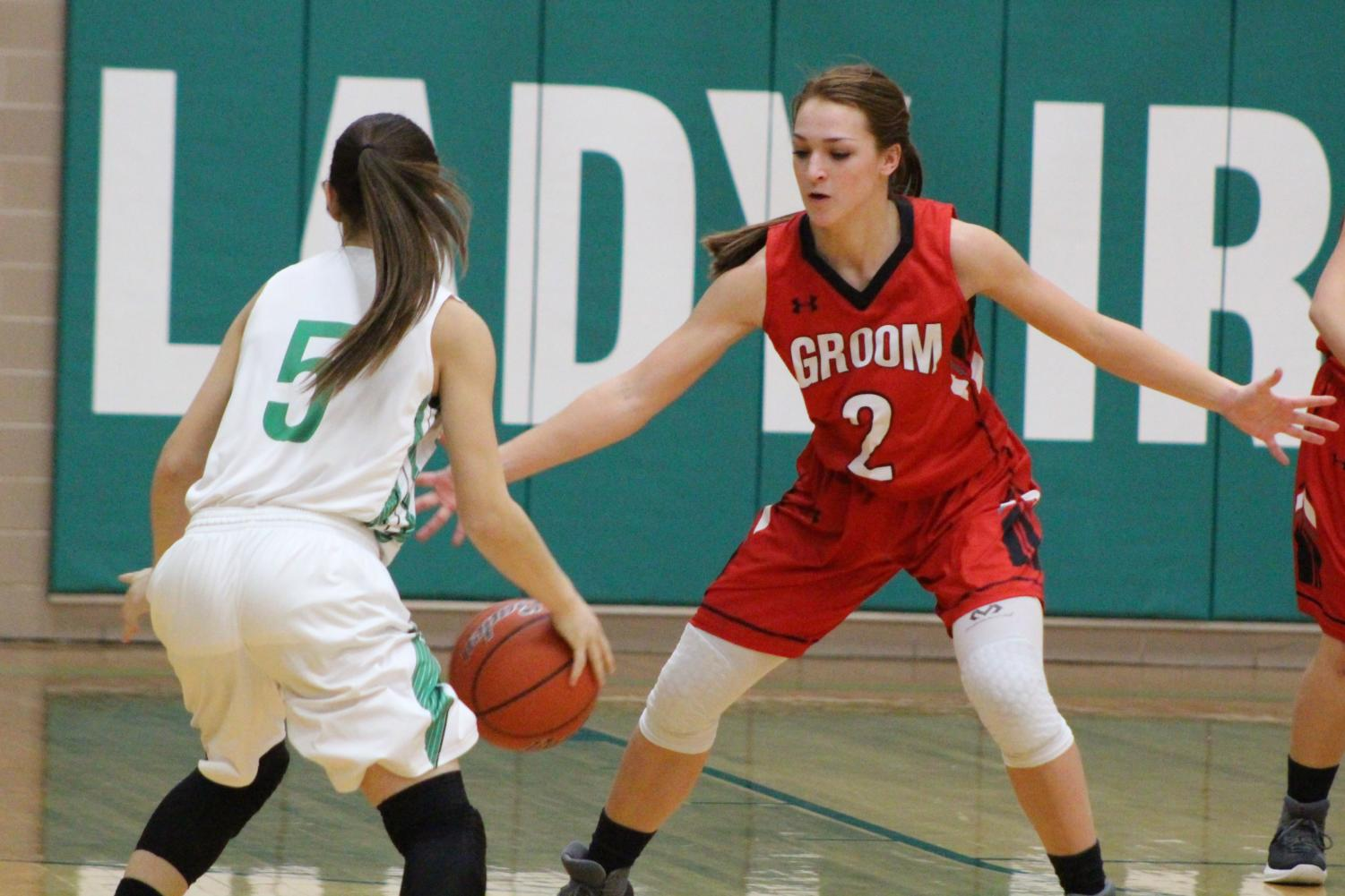 Junior basketball player Sydney Ritter plays defense against the Lady Irish during the Jan. 9 game against Shamrock. Groom won 56-43.