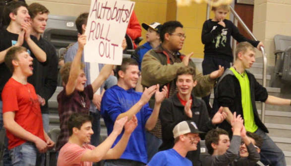 Junior varsity and varsity boys' team members cheer on the Tigerettes as they take the Bi-District Championship win against Follett Lady Panthers.  The 'Ettes won 51-25.