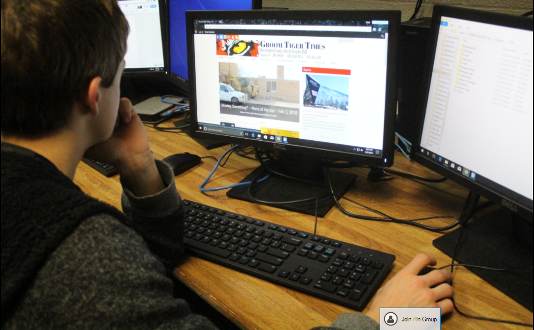 Eighth-grader Cael Ruthardt checks out the new layout of the online newspaper.  Not only is the school being changed, but the media is getting a fresh look, too.