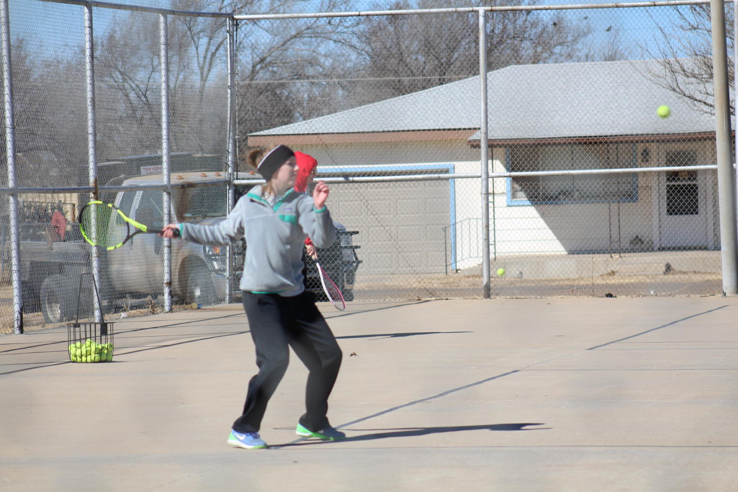 Junior Madison Friemel sets up to hit the ball. District tennis is in Randall on Monday April 2. The first matches will begin at 9 a.m.