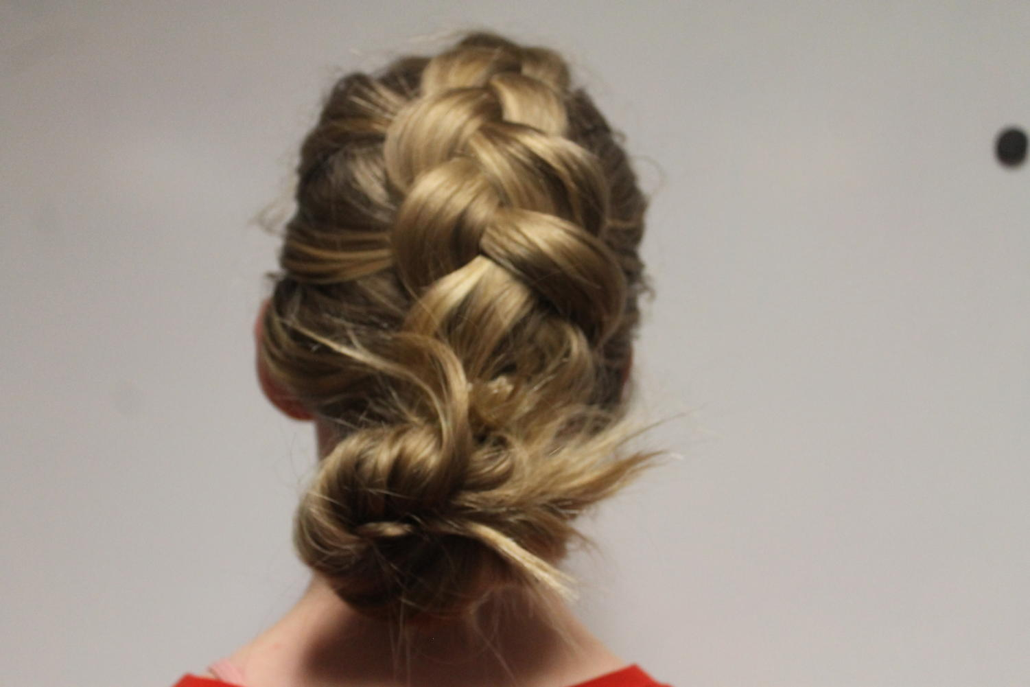 Staff photographer and columnist Saffron Eugea shows off her Dutch braid as a part of her article. The dutch braid can be used in many different ways, including the way it is shown in the image.