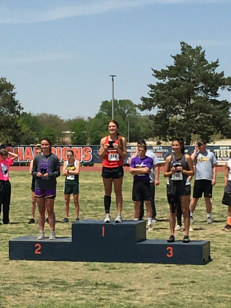 Junior  Sydney Ritter claims her first-place medal in triple jump at the Regional Track Meet, which began today, April 27, in Levelland at the South Plains College Campus. Ritter jumped 36'6.75