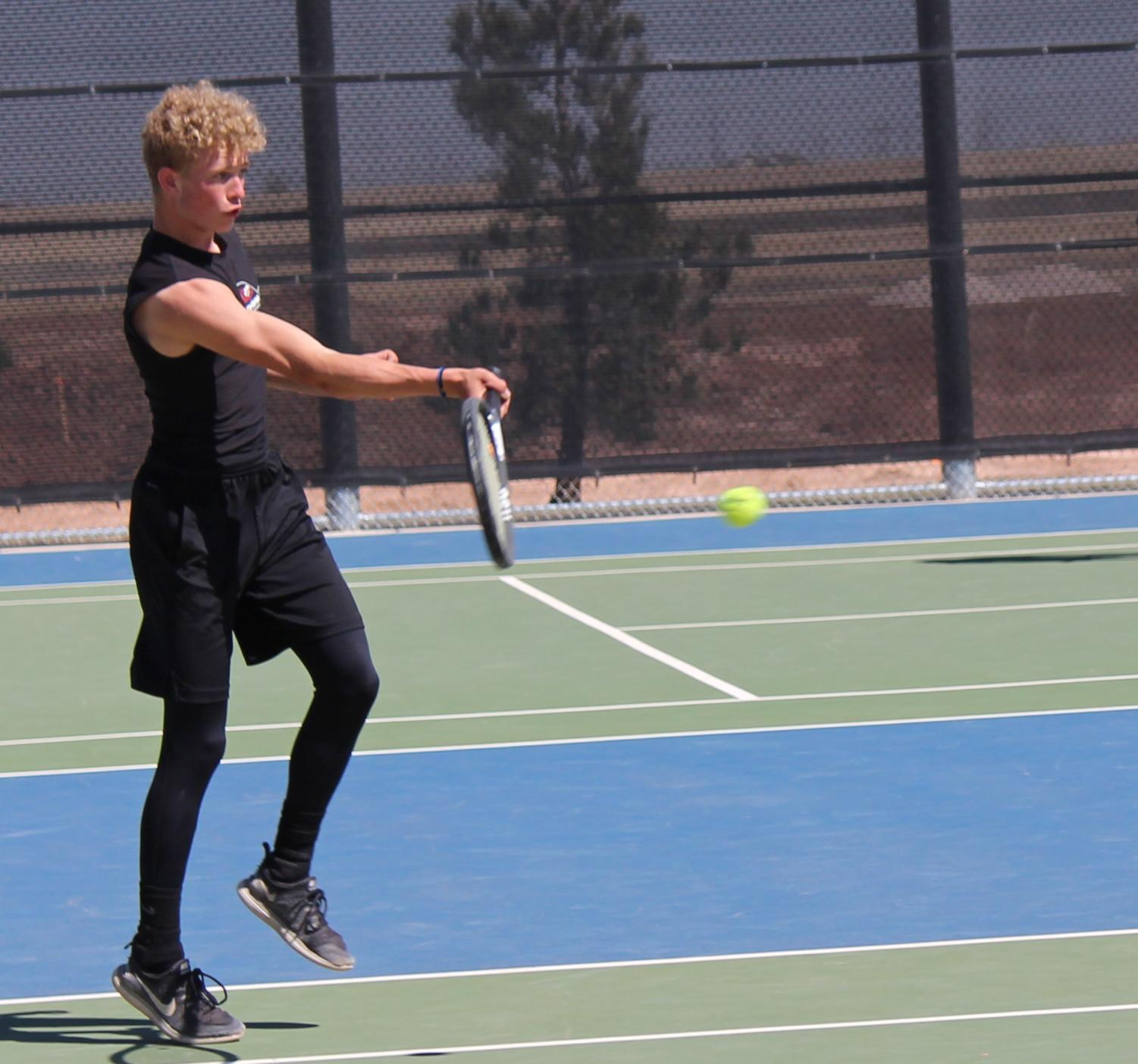 Junior Corbin Ruthardt  competes in the district tennis meet at Randall High School in Amarillo. Ruthardt is one of the four athletes that made it to the Regional tennis meet in Levelland.  Ruthardt's first match started at 9 a.m.  If the athletes win today, they will continue play tomorrow.