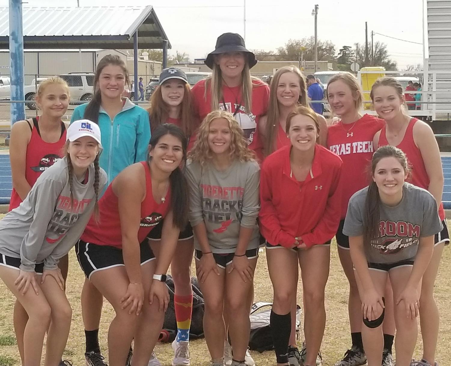 The girls track team takes a photo together after winning the meet. The team totaled 184 points giving them first place. Both the girls and the boys had many area qualifiers.