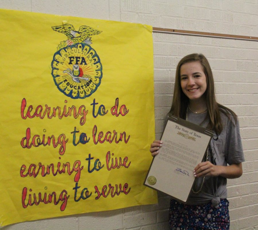 Junior Kaylie Ritter holds up a letter of recognition from the Texas House of Representatives that she recently received in the mail. This letter was acknowledging her for her success in the Texas FFA State Chorus and many other extra curricular activities. Ritter was the first from her chapter and one of the few members from Area One organization to participate at this level.
