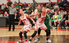 Junior Aubrey Ritter and Freshman Ali Freimel box out for the rebound against Shamrock. Photo by Hallie Thompson