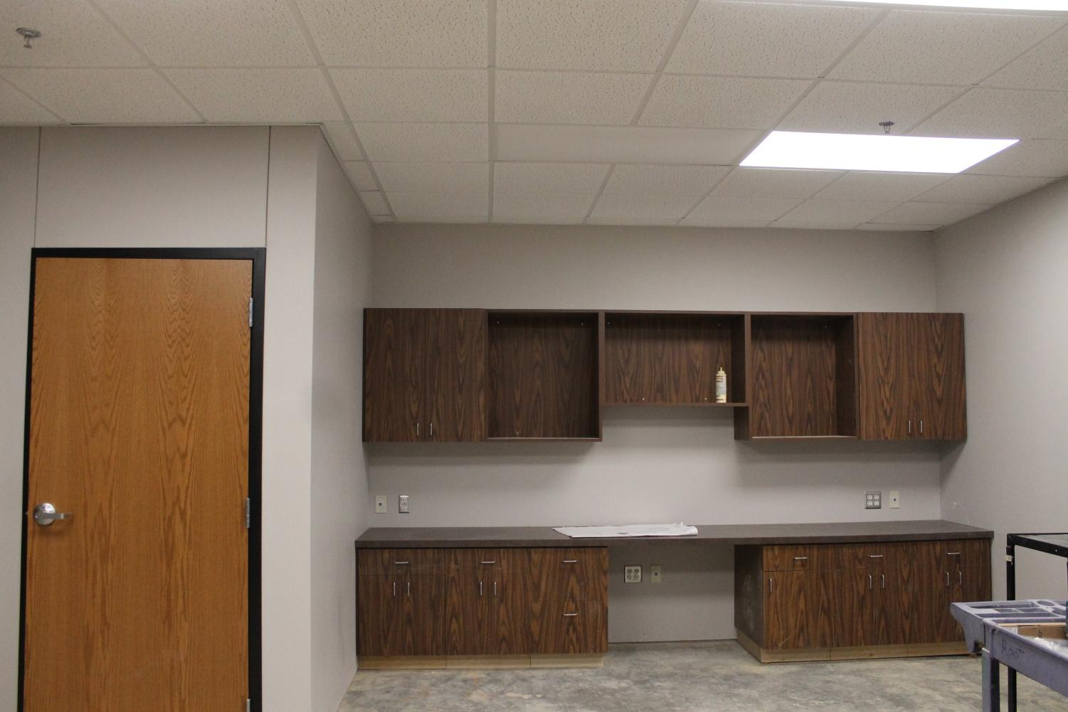 Construction+continues+in+the+new+offices.+The+cabinets+and+shelves+are+being+installed+in+Superintendent+Mr.+Lamb%27s+office.+%22I+am+very+excited+to+see+the+new+offices%2C%22+said+sophomore+Saffron+Eugea