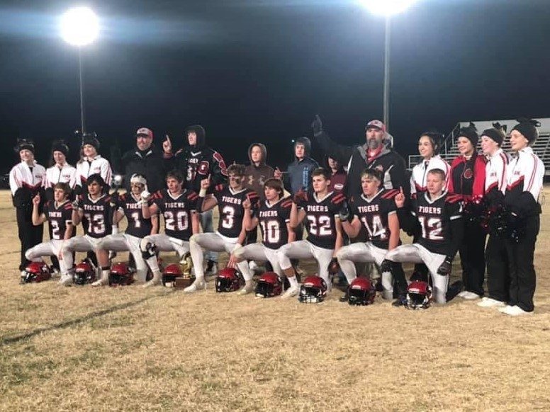 The Groom Tigers posing for a picture with the Bi-District trophy after beating the Miami Warriors in McLean. The Tigers will be moving forward on there fight for Gold Ball Trophies.